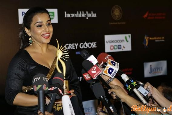 Bollywood actress Balan speaks to the media after winning the Best Actress in a Leading Role Award trophy, backstage at the IIFA Awards show in Singapore