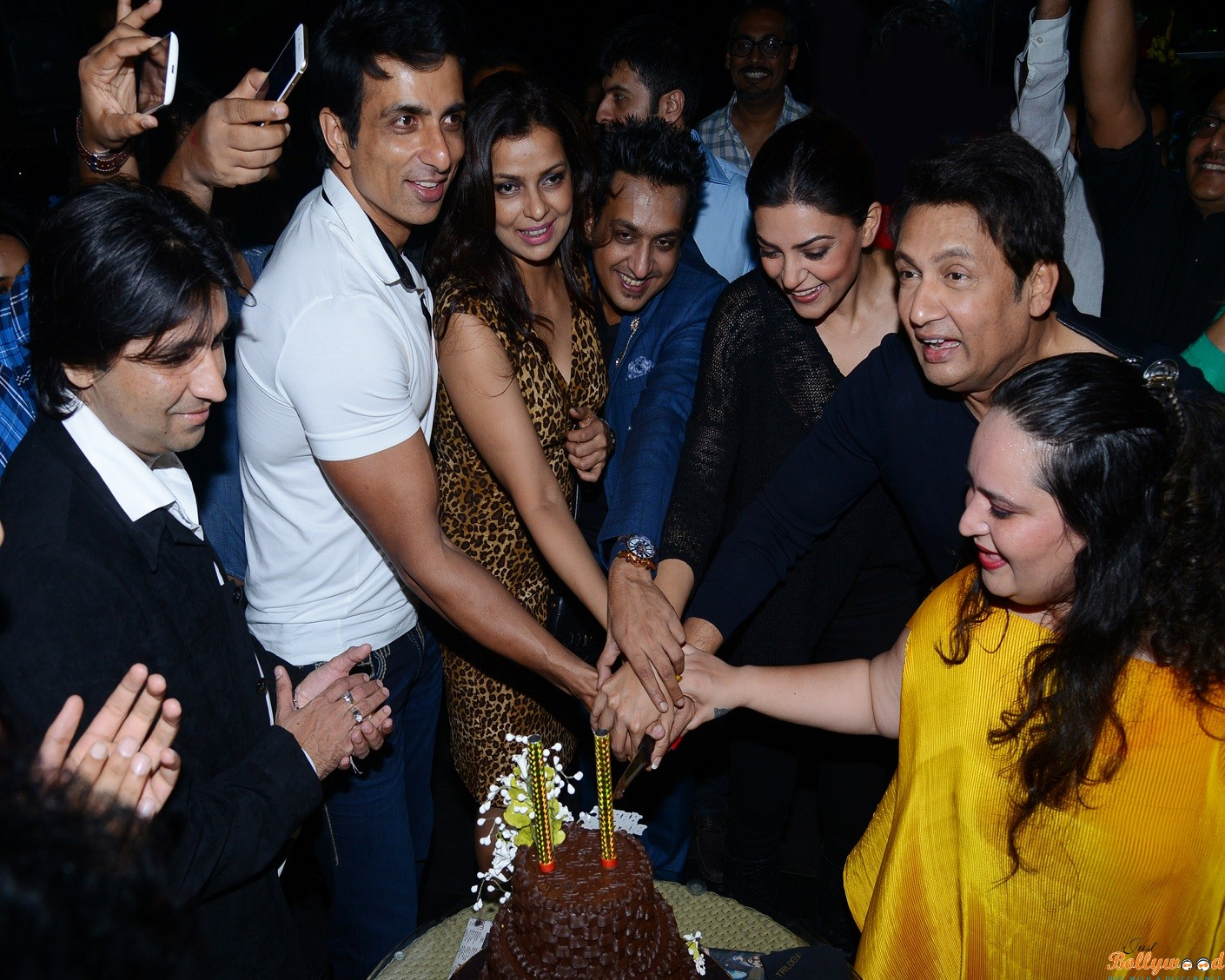 sonu sood cutting the cake group pic - 3