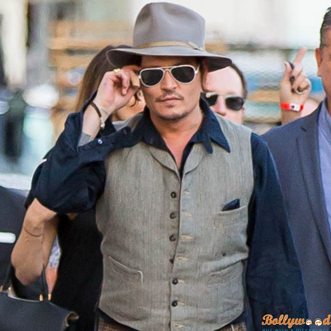 Johnny Depp signs autographs for his fans at Jimmy Kimmel Live! in Hollywood, CA