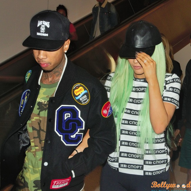 Kylie Jenner arrives to LAX with boyfriend Tyga