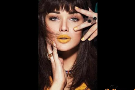 The wow look of Amy Jackson's sports yellow lips . Forget aish's purple lips!