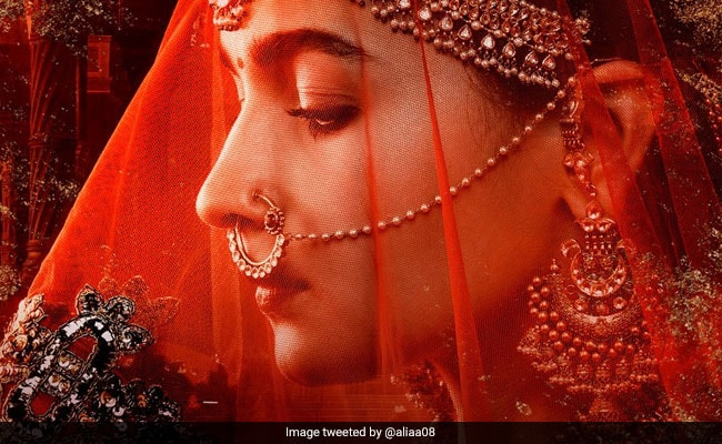 Photo of Meet the Woman of Kalank on Woman's Day in a poster featuring Alia Bhatt